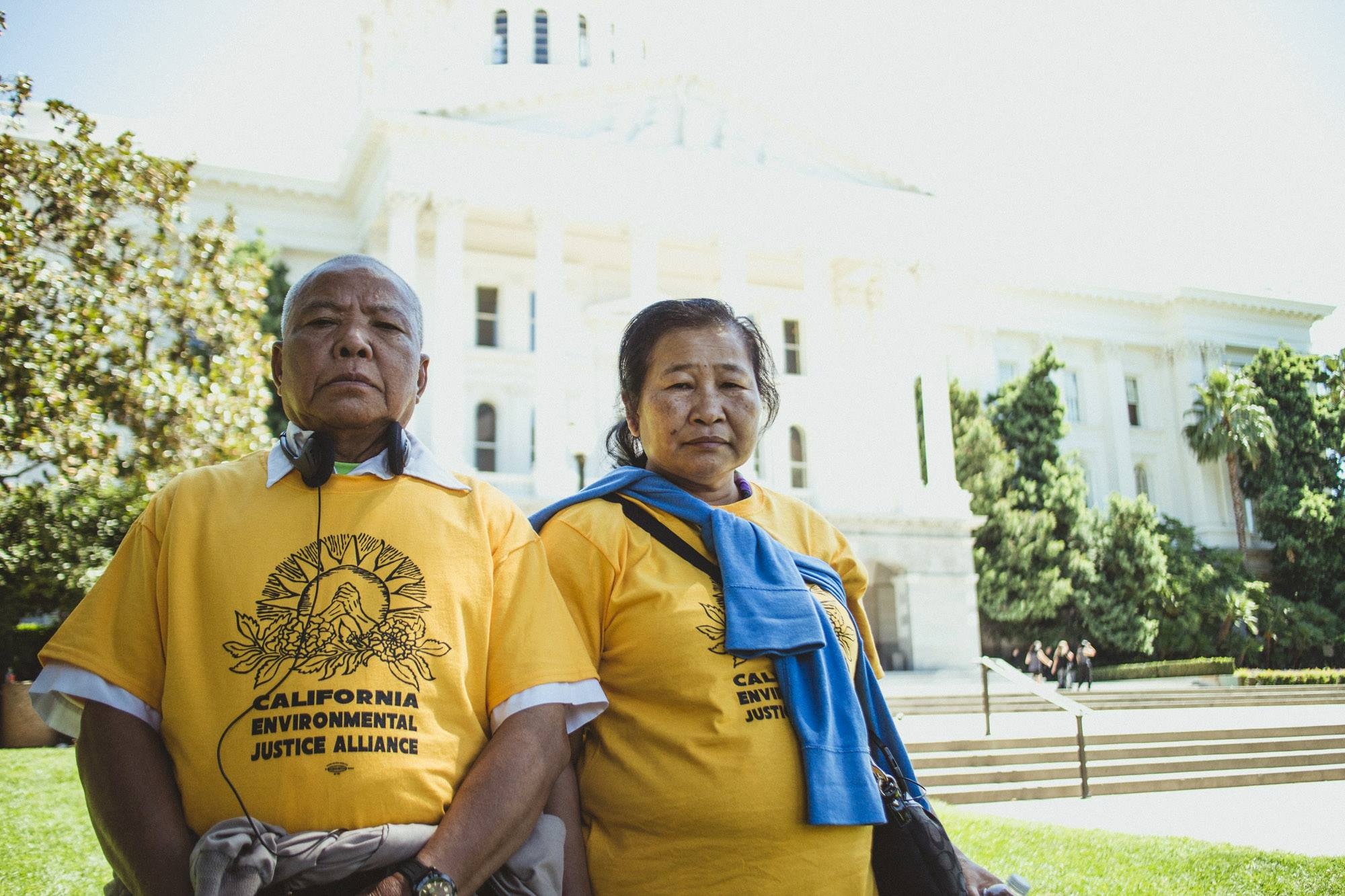 APEN leaders Lipo and Saeng Chanthanasak at the State Capitol in 2014